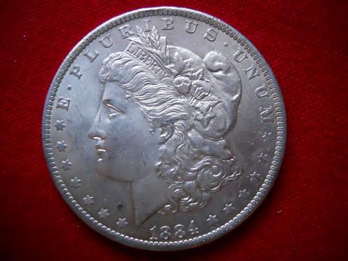 1884-O Morgan Silver Dollar.  MS-63 Grade.  Much Luster.