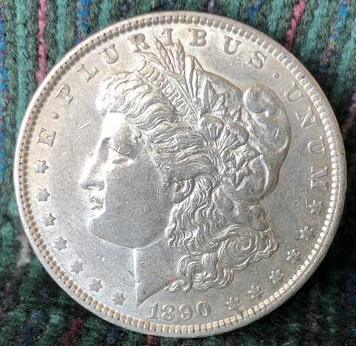 For sale a nice 1890 Philadelphia Morgan silver Dollar