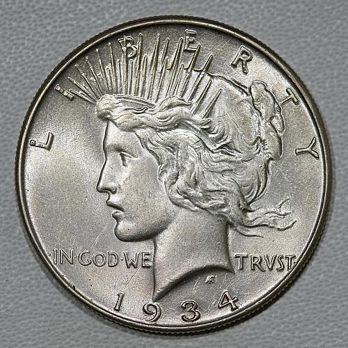 1934 Gem AU Peace Dollar, a super lustrous slider with no distracting marks