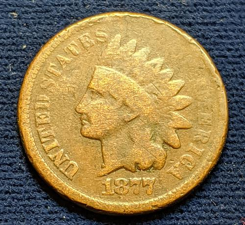 1877 GOOD INDIAN WITH SOME RIM PROBLEMS