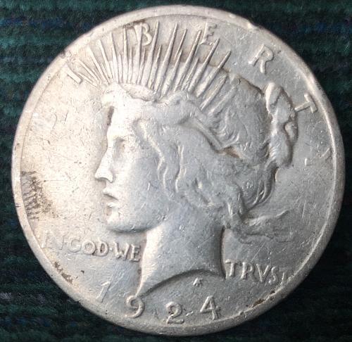 For sale a 1924 Philadelphia Peace silver Dollar