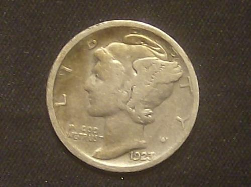 1923 s Mercury Dime Fine with nice gold toning.