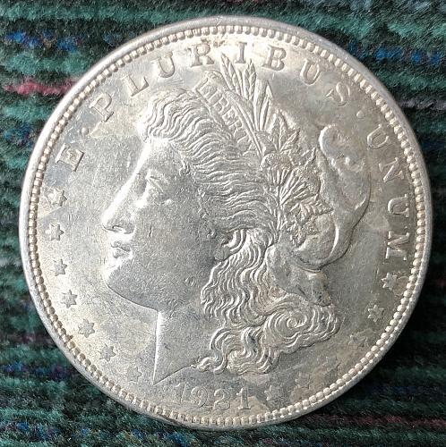 For sale a nice 1921 Philadelphia Morgan silver Dollar