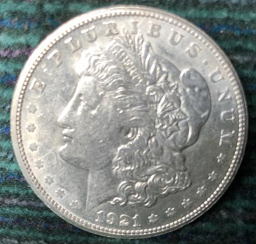 For sale a nice 1921 San Francisco Morgan silver Dollar, with nice luster