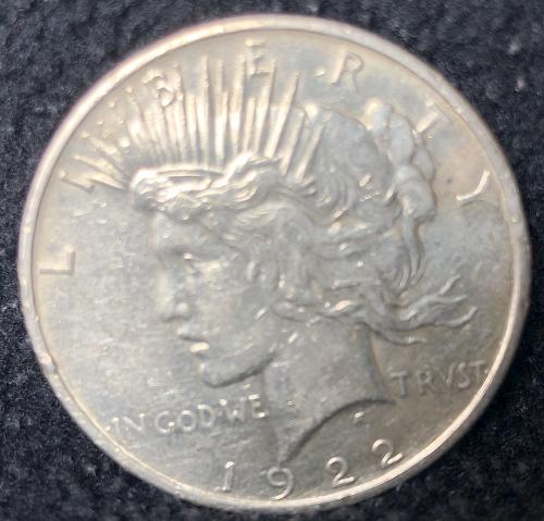 For sale a nice 1922 Philadelphia Peace silver Dollar nice luster