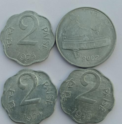 E)...India four different circulated coin