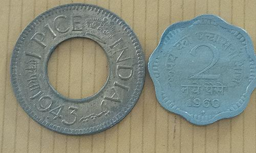 D)..Two different..India circulated coins..Large 3 (1943)