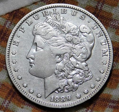 1889 O MORGAN SILVER DOLLAR,