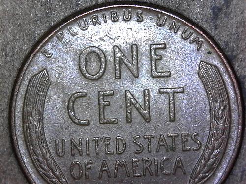 1958 - D penny obverse die chip bow tie