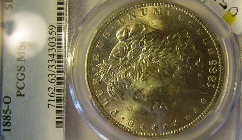 1885-O Morgan Dollar CERTIFIED NGC  MS-63 SILVER  EXPLODES !!