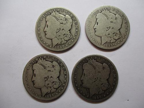 4 Low Grade Morgan Dollars.  87-O, 88-O, 89-O, and 90-O.  Item: DM Lot-03.