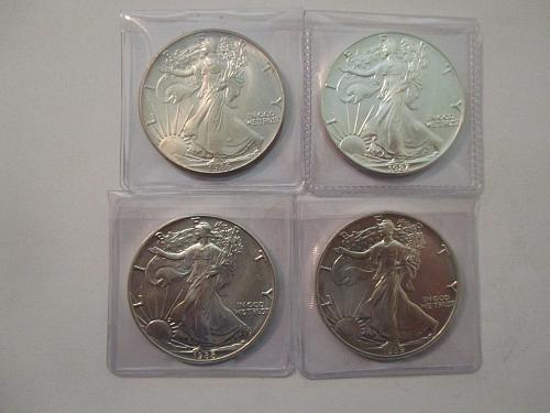 4 US Silver Eagles.  1986, 1987, 1988, and 1989.  Item: E Lot-01