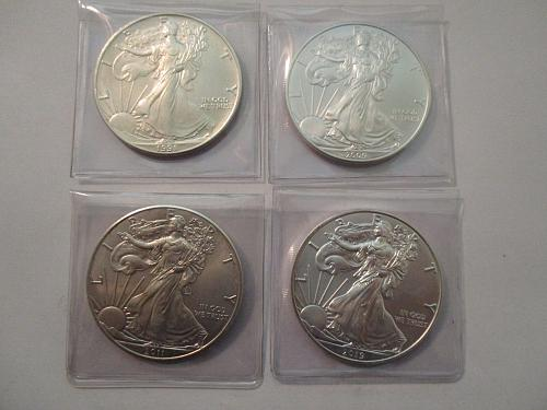 4 US Silver Eagles.  1991, 2009, 2011, and 2019.  Item: E Lot-02