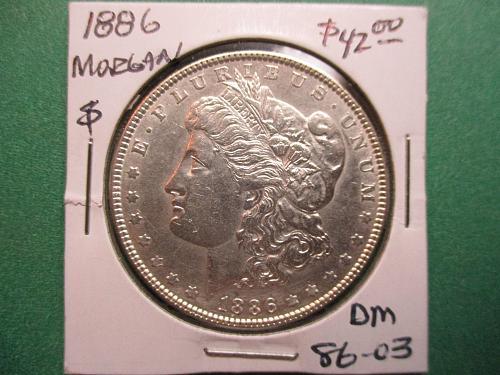 1886 Morgan Dollar.  Item: DM 86-03