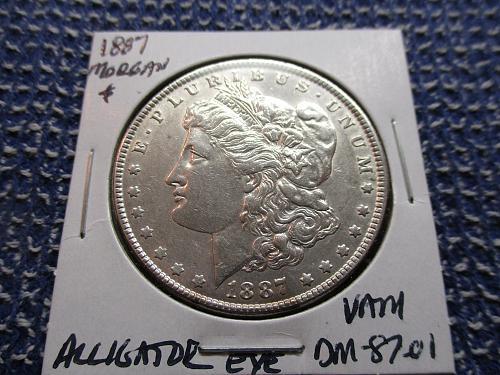 1887 AU55 Morgan Dollar.  VAM.  Item: VAM DM 87-01.