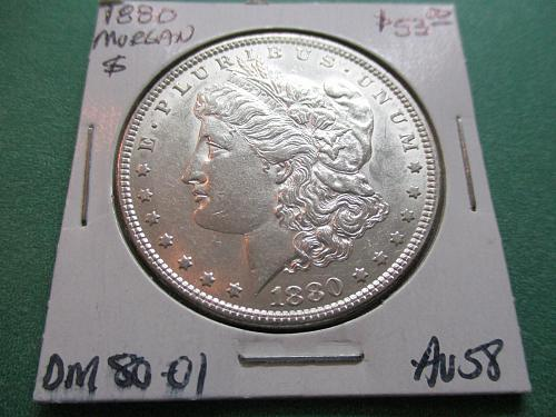 1880  AU58 Morgan Dollar.  Item: DM 80-01.