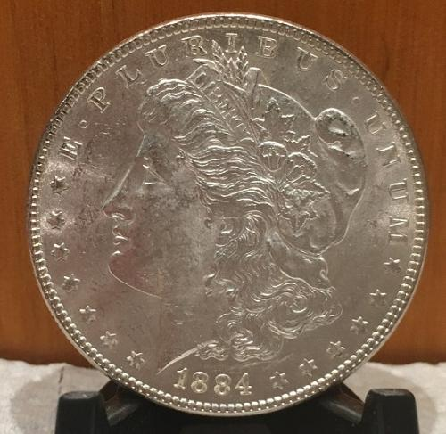 1884-P MORGAN DOLLAR UNCIRCULATED SILVER New Uncirculated fresh out the roll!