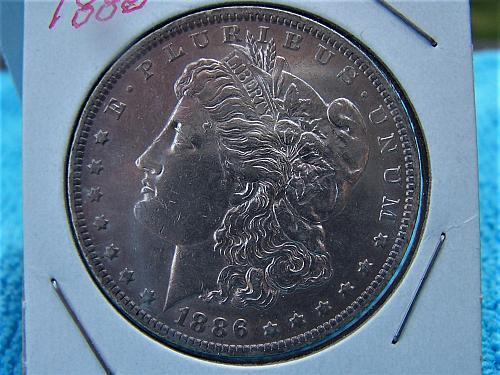1886 O -VG - AU Silver Dollar Morgan You do the grading!