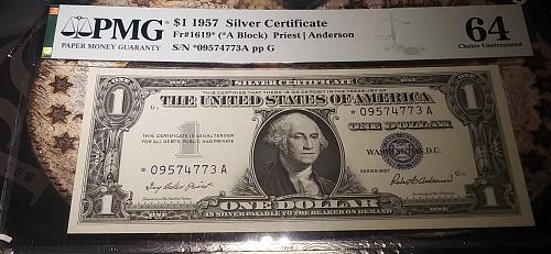 1957 $1.00  (Star Note) Silver Certificate PMG MS 64