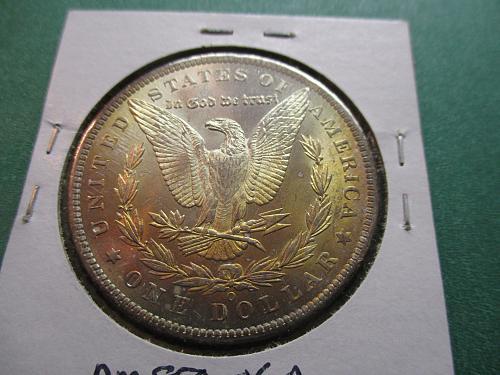 1885-O  AU58 Morgan Dollar.  Toning on Reverse.  Item: DM 85O-06.