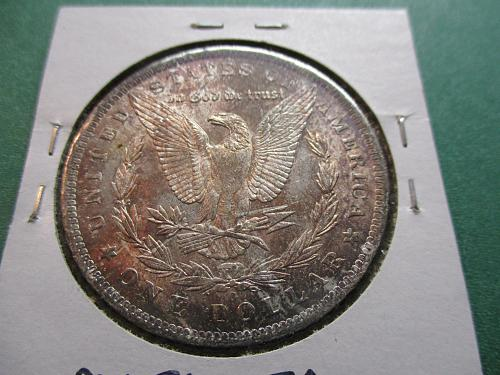1885-O  AU58 Morgan Dollar.  Toning on Obverse and Reverse.  Item: DM 85O-07.