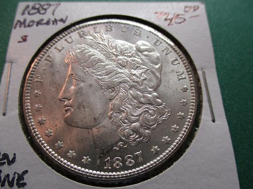 1887  MS62 Morgan Dollar.  Item: DM 87-07.