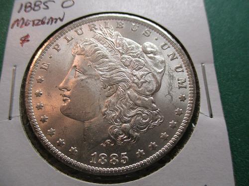 1885-O  MS62 Moran Dollar.  Item: DM 85O-09.