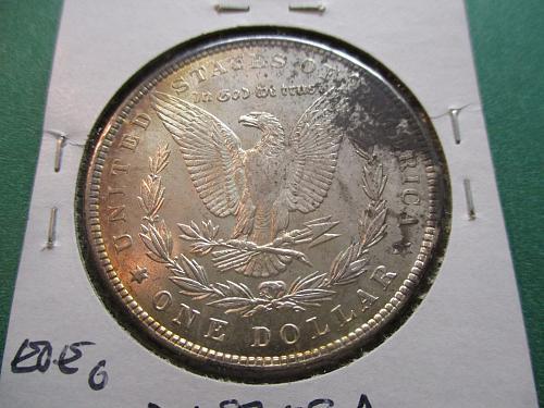 1887  MS60 Morgan Dollar.  Item: DM 87-08.