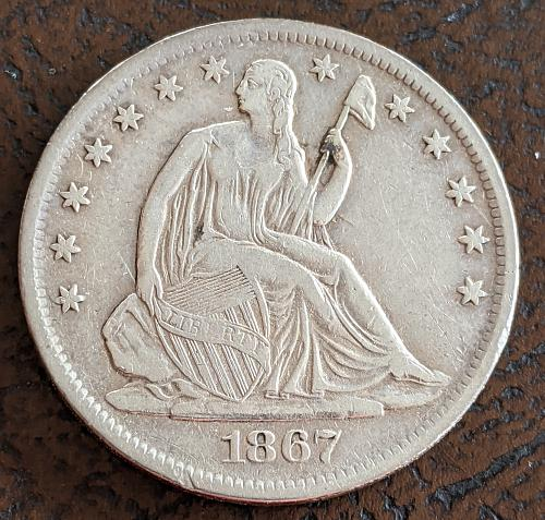 1867S VERY FINE SEATED LIBERTY HALF DOLLAR.