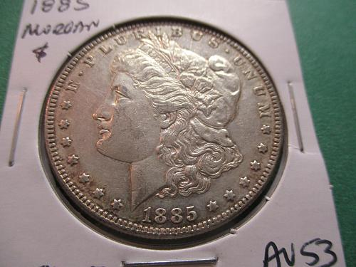 1885  AU53 Morgan Dollar.  Item: DM 85-07.