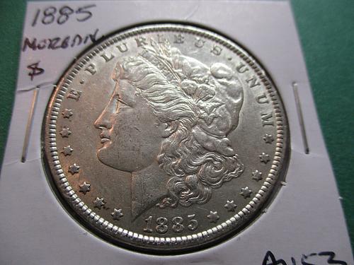 1885  AU53 Morgan Dollar.  Item: DM 85-08.