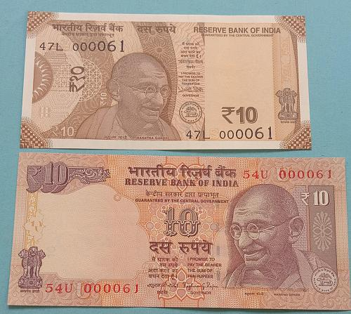 Two different..Low number..000061 .Unc India Note