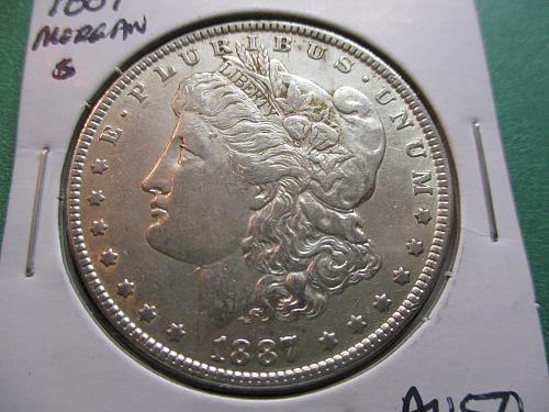 1887  AU50 Morgan Dollar.  Item: DM 87-11.