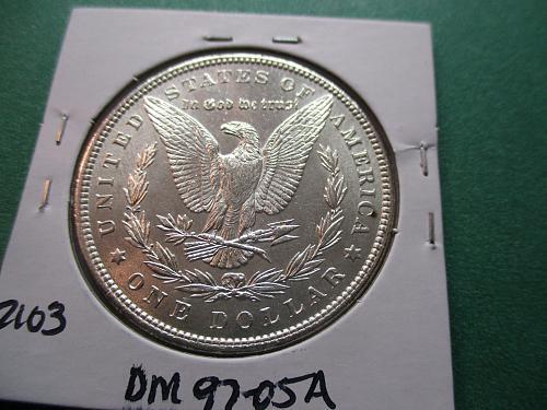 1897  MS62 Morgan Dollar.  Item: DM 97-05.