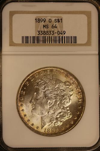 1899-O Morgan Silver Dollar NGC MS64 **Light Gold Rim Toning**