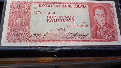 1962 BANCO CENTRAL DE BOLIVIA CIEN PESOS NOTE IN SLEEVE UNC CONDITION C-21-21