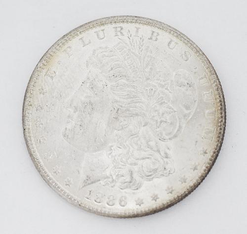 1886 MORGAN SILVER DOLLAR RARE KEY DATE LIGHT TONED RIM $1 US COIN