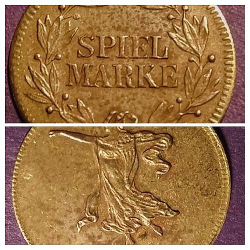 LATE 1800'S GERMAN SPIEL MARKE -- WOMAN ON GLOBE