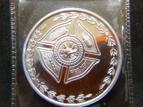 HIS SERVICE TO MANKIND FIRE FIGHTER ALUMINIUM LARGE  COIN