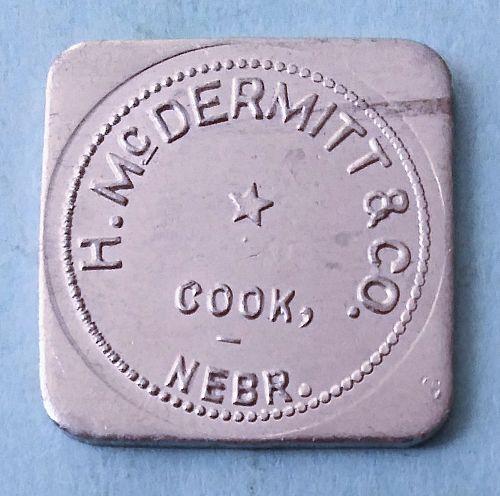 H. McDERMITT AND COMPANY COOK NEBRASKA GOOD FOR 5 CENTS TRADE TOKEN