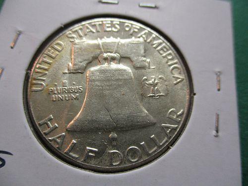 1958  AU50 Franklin Half Dollar.  Item: 50 F58-04.