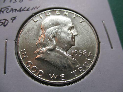 1958-D  AU58 Franklin Half Dollar.  item: 50 F58D-07.