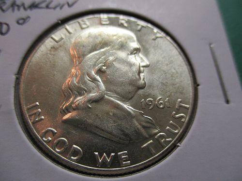 1961  AU58 Franklin Half Dollar.  item: 50 F61-04.