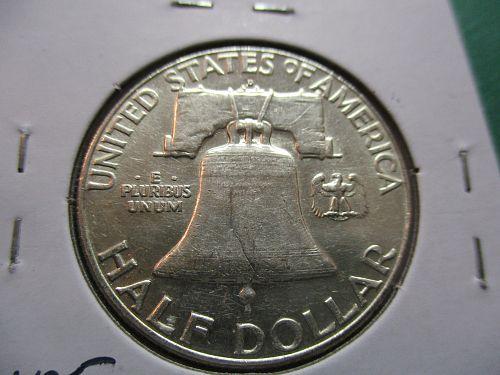 1963-D  AU58 Franklin Half Dollar.  Item: 50 F63D-24.