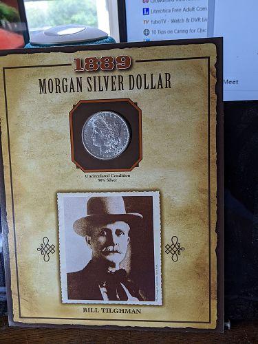 1889 morgan dollar  with stamp