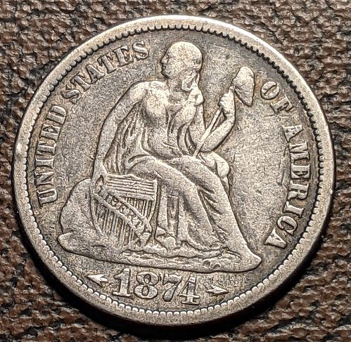 1874 WITH ARROWS VERY FINE LIBERTY DIME.